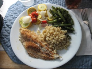 Cajun Catfish, brown rice, steamed green beans, and roasted vegetables.
