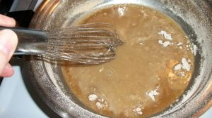 Remove from heat and whisk in broth or stock.