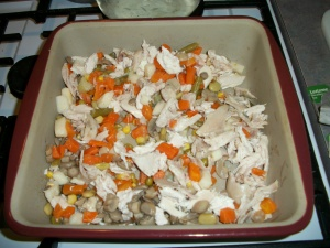 Combine drained vegetables with shredded cooked chicken in a baking dish. Preheat oven to 400°