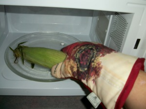 Carefully remove cooked ear of corn.