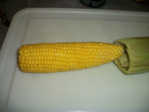 Perfectly cooked corn emerges clean of all silk and husks!