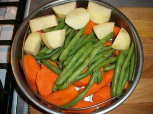 Fresh vegetables prepped in steamer basket